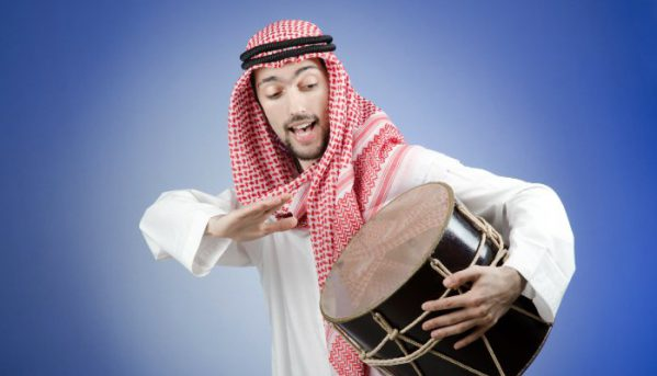 saudi-man-beating-drum-keep-volume-down